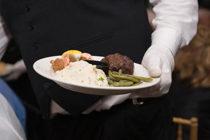 Banquet Hall waiter serving Chicago dish
